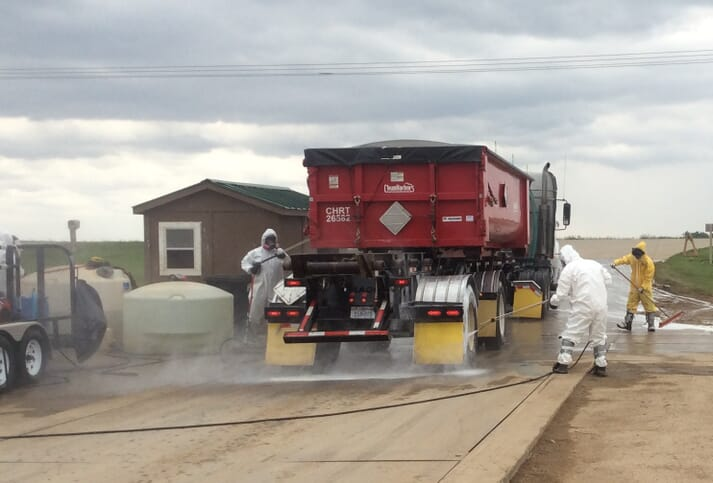 A feed lorry being disinfected before entering farm premises
