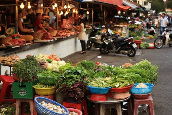 Market stall at wet market selling produce in Ho Chi Minh, Vietnam