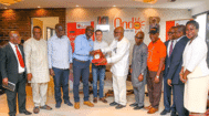 Governor Oluwarotimi Akeredolu (centre right, in white) presents Moses Makanju and Steffen Martens (Big Dutchman) with an Ondo State plaque as a sign of appreciation.
