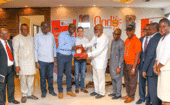 Governor Oluwarotimi Akeredolu (centre right, in white) presents Moses Makanju and Steffen Martens (Big Dutchman) with an Ondo State plaque as a sign of appreciation. thumbnail