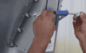 10) Attach the handle to the slide door. Move the handle up and down to ensure the gate operates smoothly. thumbnail