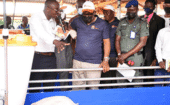 Big Dutchman Sales Manager Makanju Moses (left) shows the minister and his entourage how a pig finishing pen is set up. thumbnail