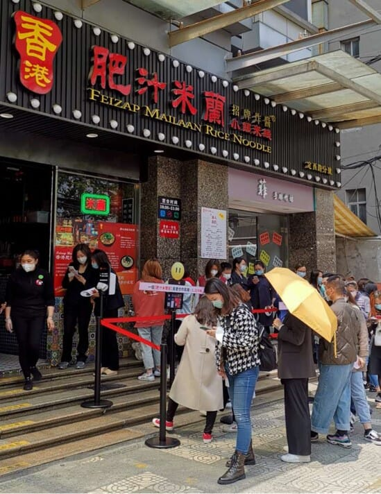 citizens wait eagerly outside of a restaurant in China that has recently re-opened after the coronavirus lockdown