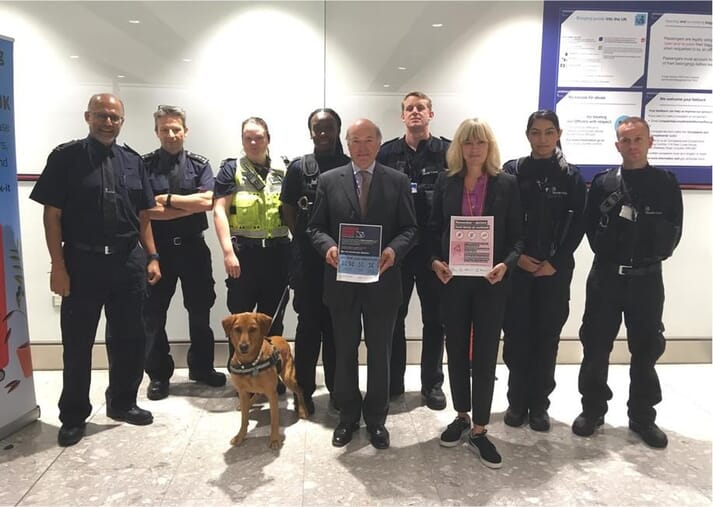 borderforce officials and sniffer dog at heathrow airport