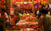 A market selling household decorations for the new year. Red is the primary colour for decorations and the festival itself; it is considered a lucky colour. thumbnail