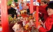 Shoppers buy decorations for lunar new year in London's Chinatown. According to Visit London, the city hosts the largest Chinese New Year celebrations outside Asia. thumbnail