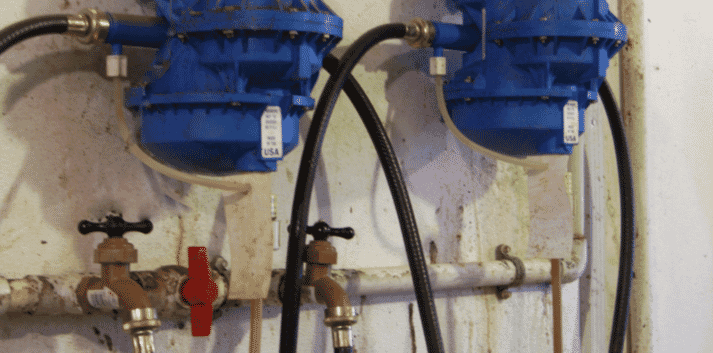 Hose bib connections and small diameter medicator supply lines reduce water flow.