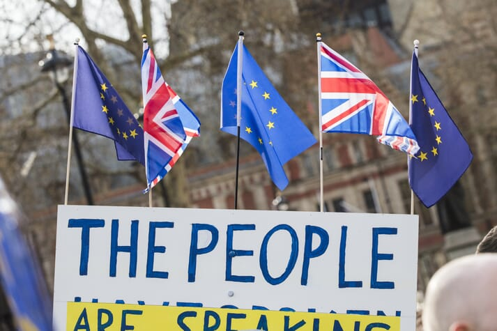 Anti-Brexit march outside Westminster with UK and EU flags