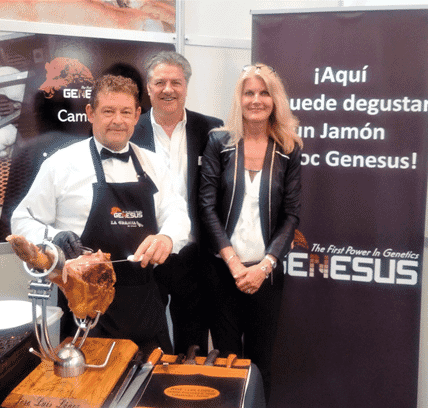 Jim Long and Sarah Long with Juan Luis, a professional butcher, slicing Genesus Duroc Serrano Ham for Figan visitors' enjoyment