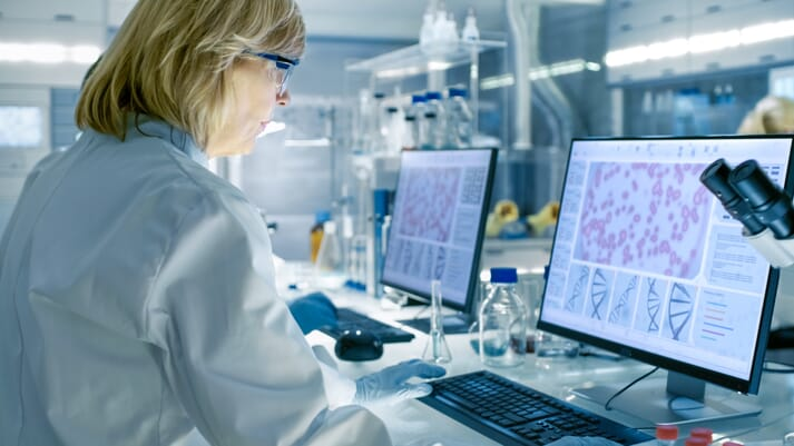 researcher studying virus dna in a laboratory