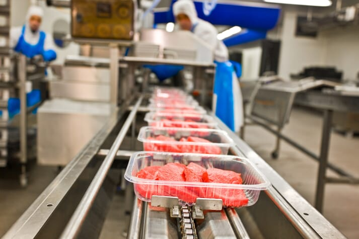 pork being packaged in a processing plant