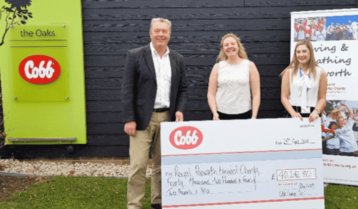 John Vincent, quality assurance director of Cobb Europe, presents Royal Papworth Hospital Charity with a cheque from funds raised at Cobb Europe Charity Clay Shoots over the last two years.