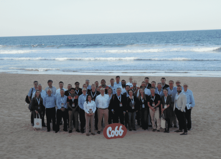 cobb attendees gathered on a beach in Sydney