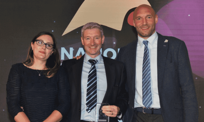 Vencomatic UK's CEO, Mr Gordon Alexander (Centre) is presented the National Egg and Poultry Award for Technology Innovation by Poultry Business magazine Editor Chloe Ryan (Left) and ex-England rugby international, Ben Kay (Right)
