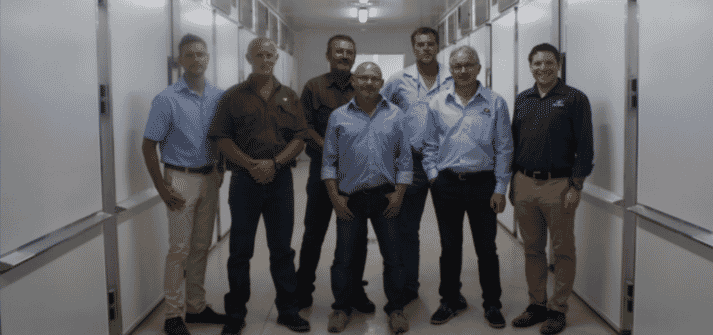 Nico Conroy, marketing director, Hy-Line South Africa (far left); Vincent Sharp (third from right), managing director of Hy-Line South Africa; Joël Audefray, general manager, ELD (second from right) and Dr. Ian Rubinoff, global technical services director (far right) visit the new hatchery with Hy-Line South Africa employees.