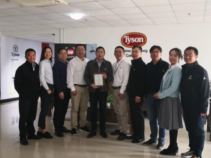 Jackson Wu (fourth from left) and Harold Zhou (fifth from right) from Cobb presented the Cobb Champion Award to Tyson Foods China Team