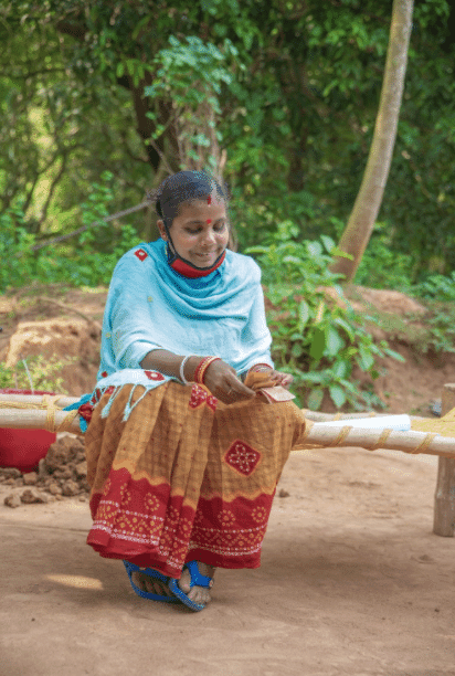 Geeta Rani Jena counts her earnings from a day's work.