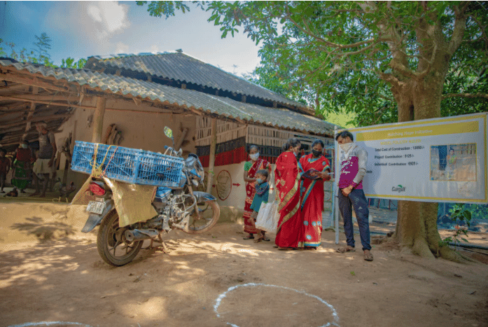The compounding effects of the Covid-19 pandemic have severely impact rural communities. Here in Odisha, India, the community has gathered to sell their chickens to a vendor who travels to remote areas by motorcycle.