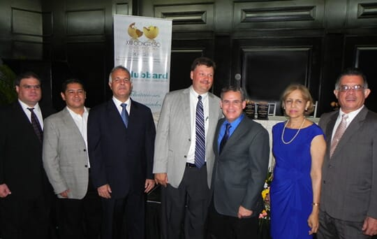 Juan Diaz (second from left) and Mark Barnes (center) from Hubbard, with members of the Panamanian Poultry Association at the awards ceremony