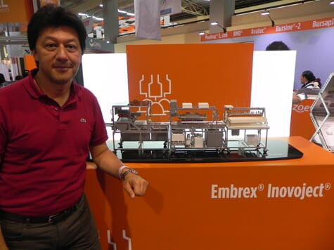 Germán Galvis of Italcol, Colombia, with the model of the full-sized Embrex Inovoject system