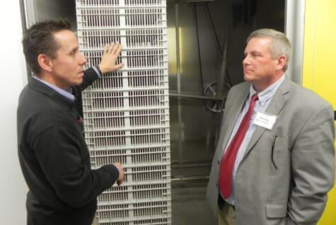 Bouke Hamminga from Pas Reform (left) explains the hatcher technology to Bill Northey, Iowa Secretary of Agriculture (right)