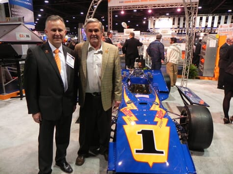 Clovis Rayzel, President of Big Dutchman, Inc (l) with Al Unser (r), four-time winner of the Indianapolis 500